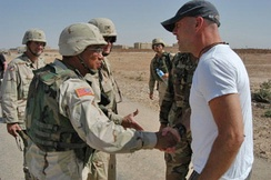 Willis meets with Brigadier General Albert Bryant, Jr and deployed soldiers from the 4th Infantry Division, in Tikrit, Iraq, during his 2003 USO tour