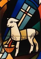 A typical depiction of Agnus Dei, bleeding into a Holy Chalice and carrying a Christian victory banner.