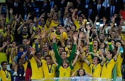 Brazilian players celebrate winning the 2013 FIFA Confederations Cup. The team had five wins in five matches.