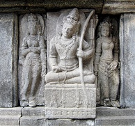 A Devata flanked by two apsaras in Prambanan temple.