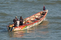 Brightly-painted fishing boats are common in Bakau