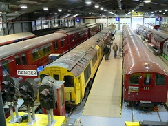 London Underground trains of different types and eras in the museum depot