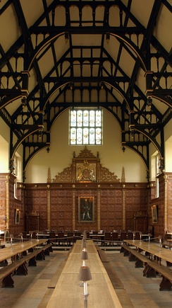 The High Table is at the far end of the dining hall under the portrait of Henry VIII