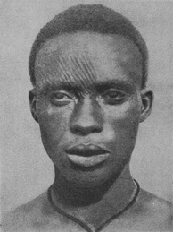 An Igbo man with facial scarifications, known as ichi, early 20th century[43]