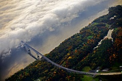 Westward commuters drive into fog which covers the Rhinecliff half of the Kingston–Rhinecliff Bridge on a fall morning