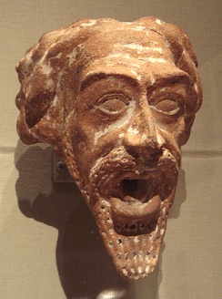 A ceramic Parthian water spout in the shape of a man's head, dated 1st or 2nd century AD
