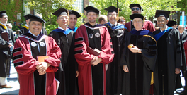 A group of new PhD graduates with their professors