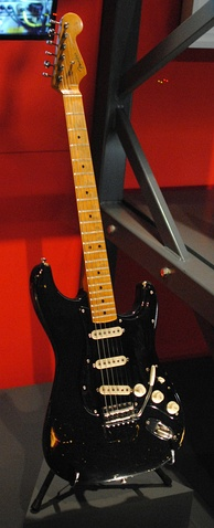 "Gilmour's ""The Black Strat"", a Fender Stratocaster, on display at the Pink Floyd: Their Mortal Remains exhibition. Considered Gilmour's primary guitar, the instrument was purchased in New York in 1970 and used on all Pink Floyd albums and shows until the mid 1980s, and at the band's Live 8 reunion.[128]"