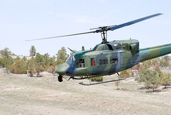 A UH-1 Iroquois (Huey) helicopter used by 37th Helicopter Squadron of the 90th Operations Group.
