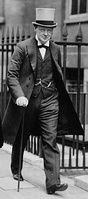 Winston Churchill in a frock coat with grey top hat.