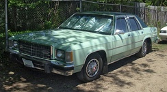 1979 Ford LTD sedan; standard trim with two headlamps.  1979 was the only year the standard LTD was fitted with a hood ornament.