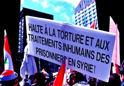 "Demonstration in Montreal in solidarity with the people of Syria. The sign reads: ""Stop torture and inhumane treatment of prisoners in Syria!"""