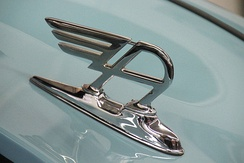 "The ""winged-A"" at the front of the bonnet/hood of new mainstream Austin models  between 1947 and 1956 recalled the ""flying-B"" on post-war Bentley models"