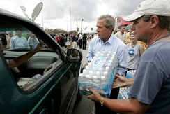 President George W. Bush helps deliver water at a relief center in Ft. Pierce, Florida.