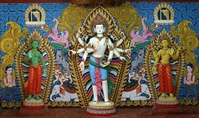 Magnificent clay images of Amoghpasha Lokesvara flanked by Arya Tara and Bhrikuti Tara enshrined at the side wing of Vasuccha Shil Mahavihar, Guita Bahi, Patan : This set of images is popular in traditional monasteries of Kathmandu Valley, Nepal.