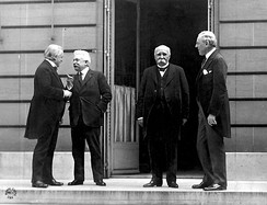 "The ""Big Four"" at the Paris Peace Conference in 1919, following the end of World War I. Wilson is standing next to Georges Clemenceau at right."