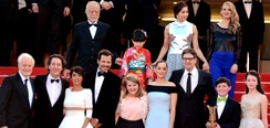 The film's crew at the Cannes Film Festival: (from bottom right) Mackenzie Foy, Riley Osborne, Mark Osborne, Marion Cotillard and other actors who provided the French and Japanese voices.