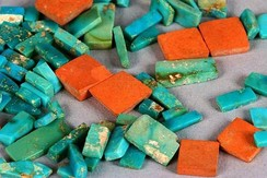 Around 200,000 pieces of turquoise have been excavated from the ruins at Chaco Canyon. These turquoise and argillite (red) beads were found at Pueblo Alto.[67]
