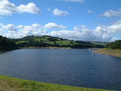 Damflask Reservoir seen from the dam wall with the hill of Ughill Heights in the background.