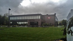 The headquarters of The DeBartolo Corporation in Boardman, Ohio with the 49ers logo on the building, signifying the team's ownership by the Youngstown-based DeBartolo-York family.