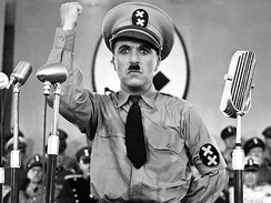 Charlie Chaplin impersonating Hitler for comic effect in the satirical film The Great Dictator (1940)