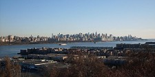The skyline of Manhattan as viewed from Mahwah, Bergen County's northernmost borough (above); and across the Hudson River from Cliffside Park, near the county's southeast border (below).