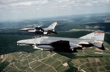 A F-4G Phantom II Wild Weasel from 480th Tactical Fighter Squadron and a F-16C Block 25 Falcon from 52d Tactical Fighter Wing Commander fly over Germany in June 1989