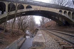 The Montclair-Boonton Line passing under the Freeman Parkway Bridge, with Toney's Brook running parallel.