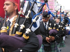 Highland bagpipes, with drone pipes over the pipers' left shoulders