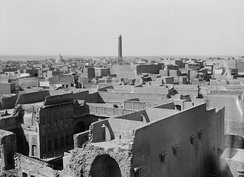 "Mosul in 1932. The leaning minaret of Great Mosque of al-Nuri gave the city its nickname ""the hunchback"" (الحدباء al-Ḥadbāˈ)"