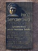 A memorial plaque on the wall of 2 Pawińskiego Street in Warsaw.
