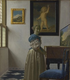 Jan Vermeer's famous painting Lady Standing at a Virginal shows a characteristic practice of his time, with the instrument mounted on a table and the player standing.