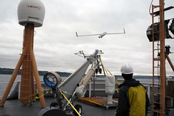 A ScanEagle is launched from NOAAS Oscar Dyson (R 224) in Puget Sound in mid-October 2008.