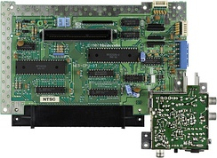 The motherboard of the NES. The two largest chips are the Ricoh-produced CPU and PPU.