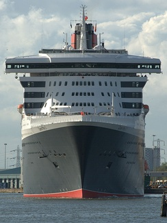 The RMS Queen Mary 2 showing bridge with enclosed bridge wings that permit a view along both sides of the vessel.