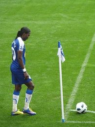 Wigan Athletic player Hugo Rodallega standing by the corner flag, about to take a corner kick
