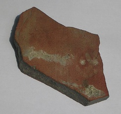 Roman roof tile fragment (78 mm wide by 97 mm high) found in York, England, with the impression of a kitten's paw