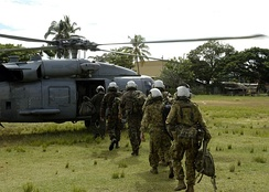 New Zealand and Australian military personnel boarding a Sea Hawk helicopter as part of the Regional Assistance Mission to Solomon Islands in 2007