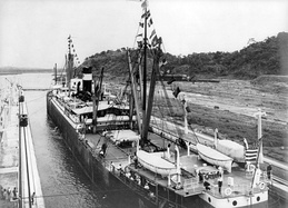 The first ship to transit the canal, the SS Ancon, passes through on 15 August 1914