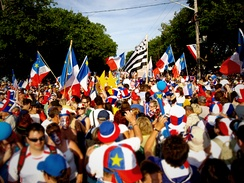 Acadians celebrating the Tintamarre and National Acadian Day in Caraquet, New Brunswick.