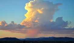 Isolated cumulonimbus cloud over the Mojave Desert, releasing a heavy shower