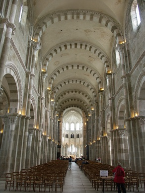 Abbey of St Mary Magdalene, Vézelay, (consecrated 1104) has clusters of vertical shafts rising to support transverse arches and a groin vault. The dressed polychrome stonework has exquisitely detailed mouldings. East end is Gothic.