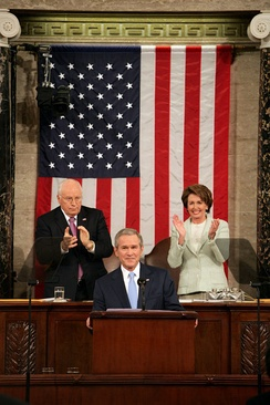 "Speaker Nancy Pelosi (right) with Vice President Dick Cheney behind President George W. Bush at the 2007 State of the Union Address making history as the first woman to sit behind the podium at such an address. President Bush acknowledged this by beginning his speech with the words, ""Tonight, I have a high privilege and distinct honor of my own — as the first president to begin the State of the Union message with these words: Madam Speaker"".[25]"