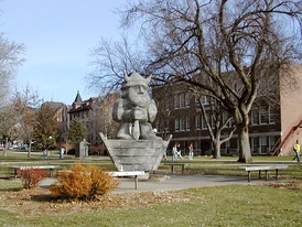 Augustana University's mascot, Ole, with the Administration Building, East Hall, and Old Main visible in the background