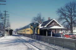 A CNW-branded commuter service stops at Wilmette, IL in 1963.