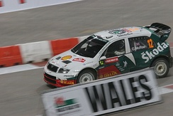 McRae driving a Škoda Fabia WRC on the Millennium Stadium, Cardiff super special stage of the 2005 Rally GB.