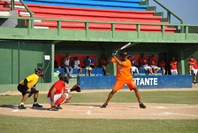 Rentería holding a bat over his shoulder while wearing an orange uniform.