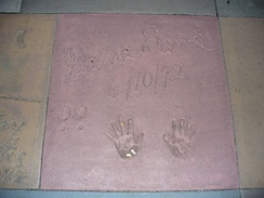 The handprints of Geena Davis in front of The Great Movie Ride at Walt Disney World's Disney's Hollywood Studios theme park.
