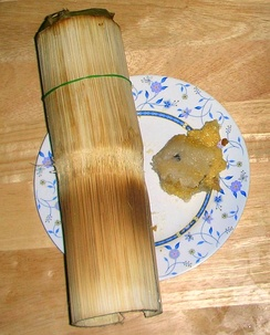 Khao lam (Thai: ข้าวหลาม) is glutinous rice with sugar and coconut cream cooked in specially prepared bamboo sections of different diameters and lengths