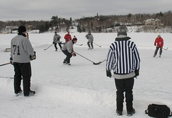 A game of pond hockey being played in Lac-Beauport, Quebec